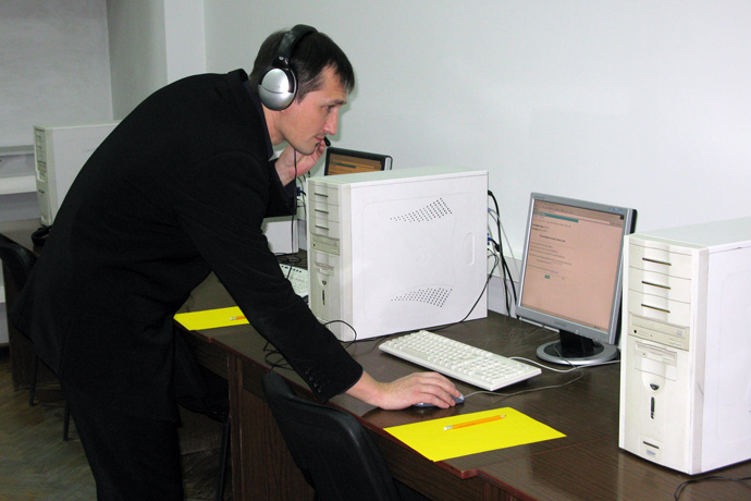 ACADEMY OF ECONOMIC STUDIES - STN10356A. The TOEFL iBT administrator from the American Councils office in Moldova is checking the equipment before the test. December 11, 2009.