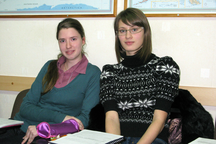 Filling out course evaluation forms at Terra Nova. From left to right: Cristina Hmelniţcaia and Livia Cebotari. TOEFL Preparation / Section 3 (Tu.Th. Afternoon Group). December 2012.