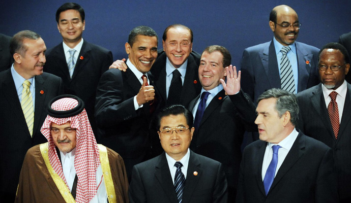 At center, President Obama, Italy's Prime Minister Silvio Berlusconi, and Russa's President Dmitry Medvedev, react as they take part in a group photo to mark the G20 summit in London on April 02, 2009. Others in the group in the front row are Saudi Foreign Minister, Prince Saud Al-Faisal; China's President, Hu Jintao and Britain's Prime Minister,Gordon Brown. Center left is Turkey's Prime Minister Recep Tayyip Erdogan, Thailand's Prime Minister, Abhisit Vejjajiva is seen top left. At right is South Africa's President, Kgalema Motlanthe while at top right is Ethiopia's Prime Minister, Meles Zenawi.