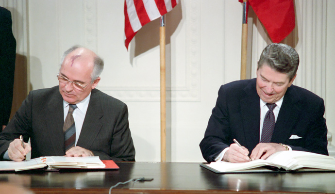 Soviet leader Mikhail Gorbachev, left, and U.S. President Ronald Reagan sign the INF Treaty to reduce the number of nuclear arms on December 8, 1987.