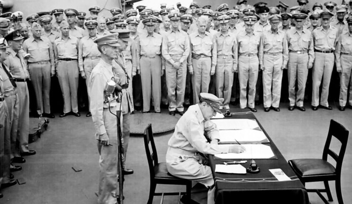 Douglas MacArthur signs the formal surrender of Japanese forces on the USS Missouri, September 2 1945.