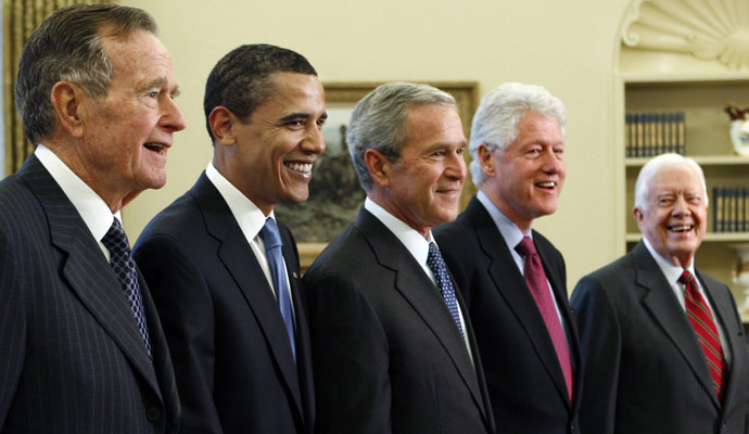 U.S. PRESIDENTS: George H.W. Bush, George W. Bush, Barack Obama, Bill Clinton, and Jimmy Carter, posing on Wednesday, Jan. 7, 2009, in the Oval Office of the White House in Washington. (Photo credit AP Photo/J. Scott Applewhite)