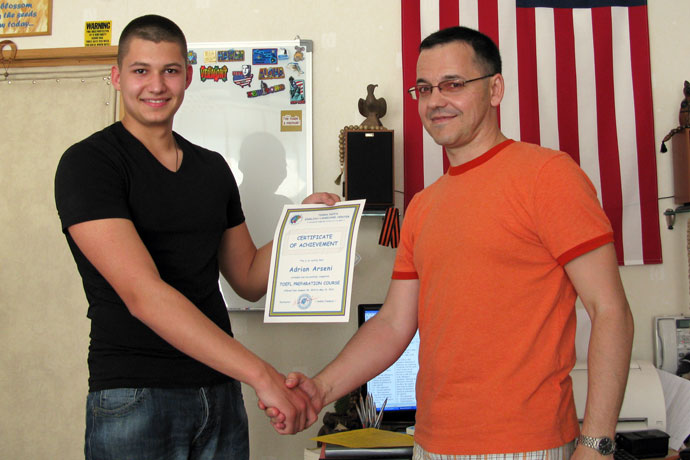 Commencement at Terra Nova. Adrian Arseni receiving his Certificate of Achievement from Andrei Fiodorov (the TOEFL instructor). TOEFL Preparation / Section 2 (M.W.F. Afternoon Group). May 2010.