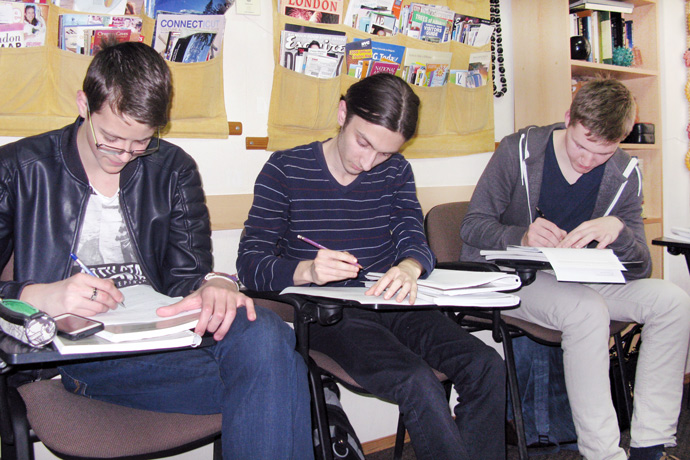 Filling out course evaluation forms at Terra Nova. From left to right: Cristian Corjan, Iurie Buzenco, and Vladislav Ciuș. TOEFL Preparation / Section 1 (M.W.F. Afternoon Group). April 2016.