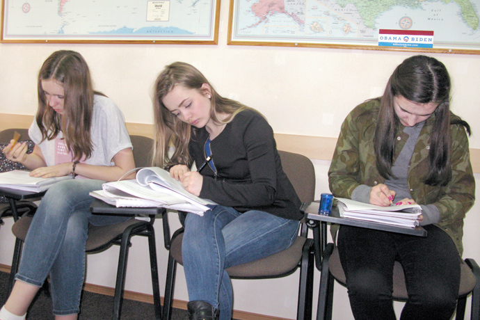Filling out course evaluation forms at Terra Nova. From left to right: Alexandra Lazari, Iana Pînzari, and Gabriela Tecuci. TOEFL Preparation / Section 1 (M.W.F. Afternoon Group). April 2016.