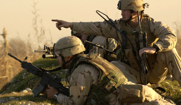 U.S. Army Special Forces Soldiers scan an area during a recent patrol in Iraq.